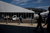 People walk outside the media tents at the Wells Fargo Center on July 24 2016 in Philadelphia Pennsylvania Preparations continue for the start of the...