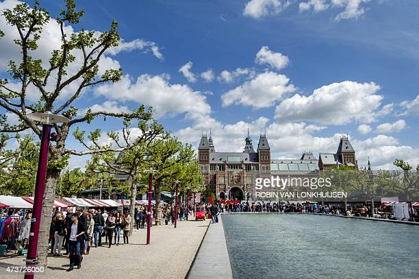 People walk outside the Rijksmuseum in Amsterdam on May 17 2015 The Dutch Rijksmuseum museum was awarded the 2015 European Museum of the Year Award...