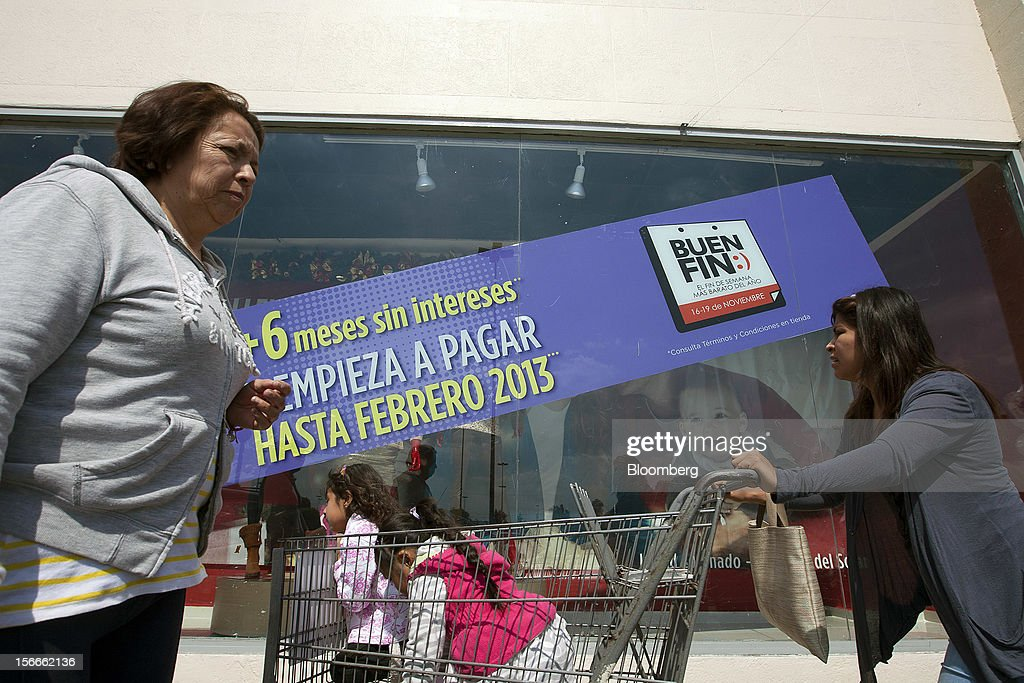 People walk outside Wal-Mart de Mexico SAB de CV's Suburbia store in Mexico City, Mexico on Saturday, Nov. 17, 2012. El Buen Fin, Mexico's equivalent of Black Friday, when the year's biggest discounts are offered by participating stores, is held on the third weekend of November and will run through Nov. 19. Photographer: Susana Gonzalez/Bloomberg via Getty Images
