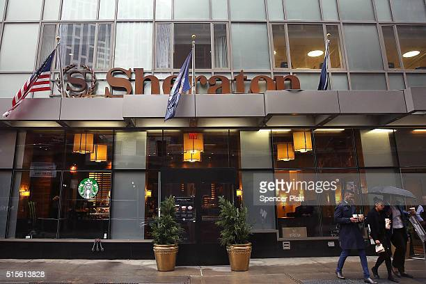People walk pass a Sheraton Hotel in downtown Brooklyn on March 14 2016 in New York City A fight for the Starwood Hotel chain which Sheraton is a...