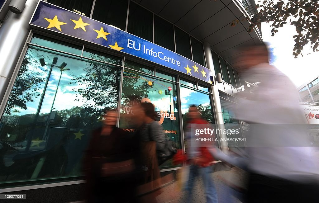 People walk pass the European Commission's building in Skopje on October 12, 2011. The European Commission has endorsed the Republic of Macedonia for EU accession talks for a third consecutive year. AFP PHOTO / ROBERT ATANASOVSKI