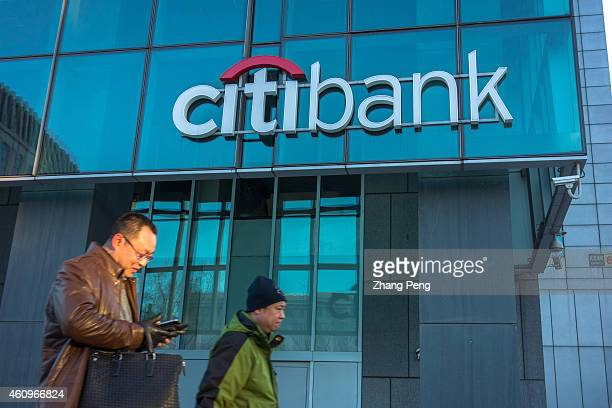 People walk passed a Citibank branch In 2015 China will further ease the restrictions on branch openings and Yuan transactions by foreign banks as it...
