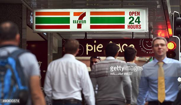People walk past a 7Eleven convenience store in Sydney's central business district on September 30 2015The chairman and chief executive of 7Eleven...