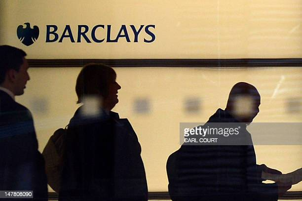 People walk past a Barclays logo at the bank's headquarters in Canary Wharf in east London on July 3 2012 Barclays on Tuesday said that its chief...