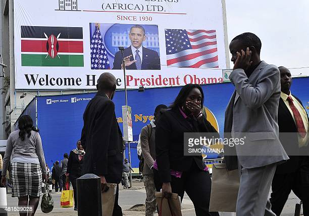 People walk past a billboard welcoming US President Barack Obama on July 22 2015 in Nairobi ahead of his visit Obama will make his first presidential...