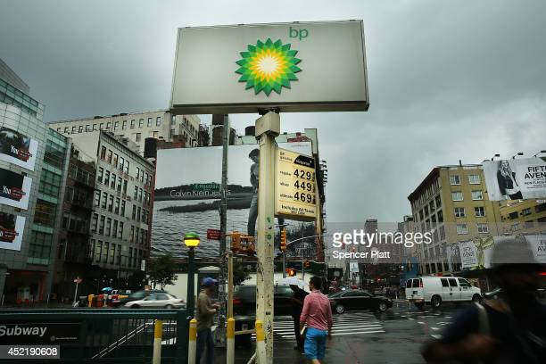 People walk past a BP gas station one of the few remaining gas stations left in lower Manhattan which is scheduled to close next year on July 15 2014...