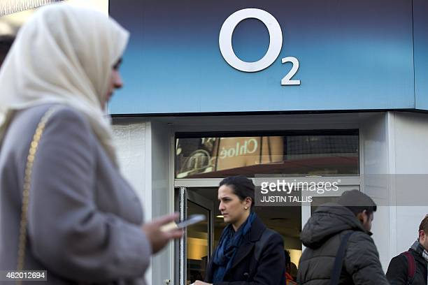 People walk past a branch of an O2 store in central London on Janurary 23 2015 Hong Kong tycoon Li KaShing's Hutchison Whampoa said on January 23...