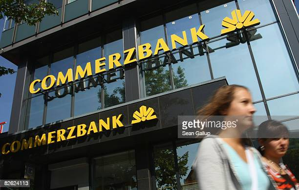 People walk past a branch of Commerzbank on September 2 2008 in Berlin Germany German insurer Allianz which bought Dresdner Bank for EUR 24 billion...
