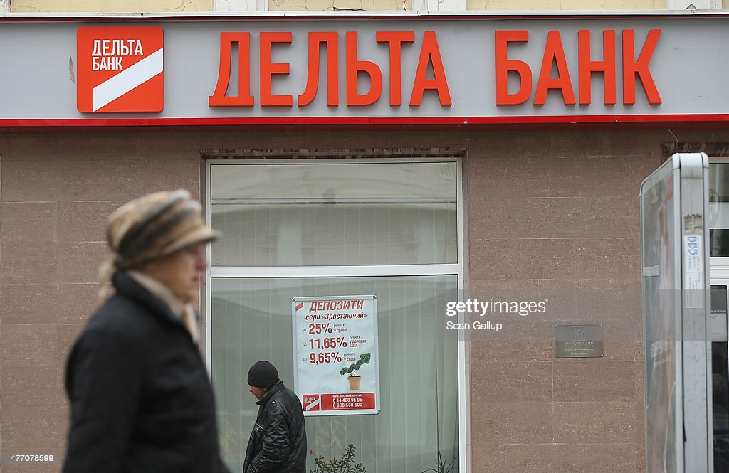 People walk past a branch of Delta Bank on March 7, 2014 in Simferopol, Ukraine. Banks in Ukraine have begun imposing limits on the amount of money individuals can withdrae per day, and both the Ukrainian hryvnia and the Russian rouble have fluctuated strongly against western currencies in the last week as tensions in Crimea have risen. The Crimean Parliament voted yesterday to hold a referendum on March 16 to determine whether Crimea shall secede from Ukraine and join Russia.