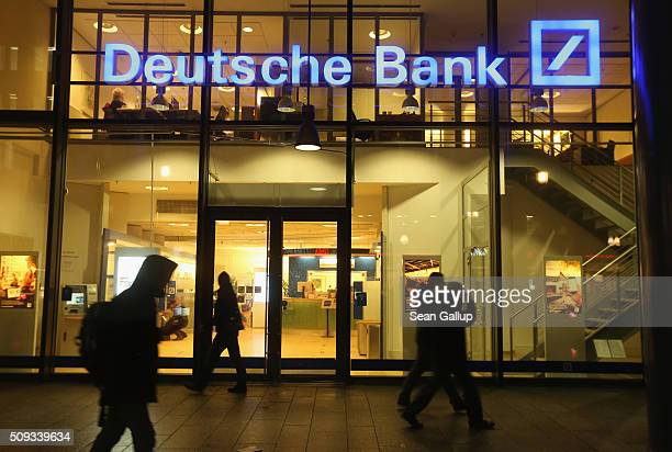 People walk past a branch of Deutsche Bank on February 9 2016 in Berlin Germany Shares of Deutsche Bank rose 16% on the Frankfurt stock exchange on...