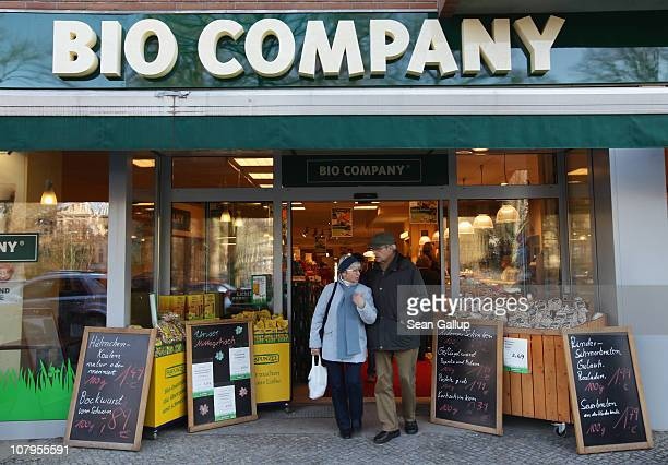 People walk past a branch of German organic grocery store chain Bio Company on January 10 2011 in Berlin Germany Organic foods retailers are...