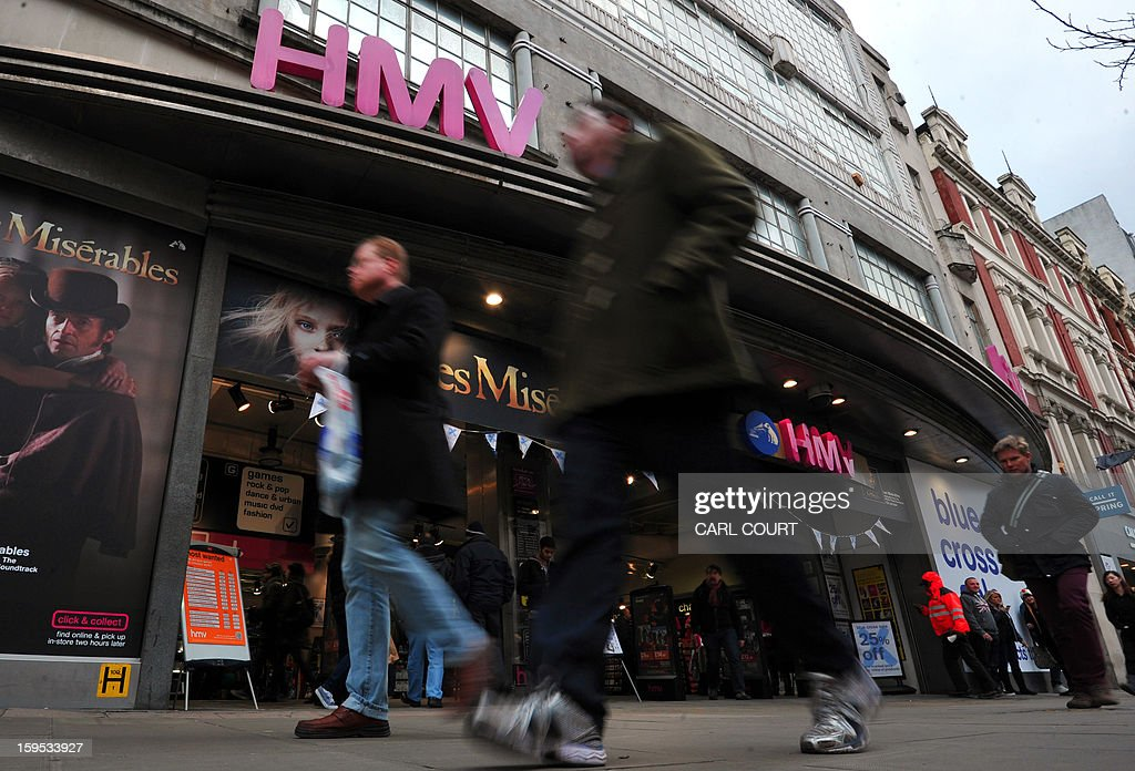 People walk past a branch of the music retailer HMV in central London on January 15, 2013. Iconic British music retailer HMV was fighting for its survival on Tuesday after the group looked to the Deloitte financial group to help save it from a collapse which could see the loss of more than 4,000 jobs.