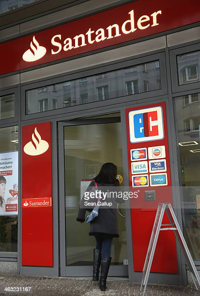 People walk past a branch Spanish bank Santander on January 17 2014 in Berlin Germany Banks across Europe will be announcing their financial results...