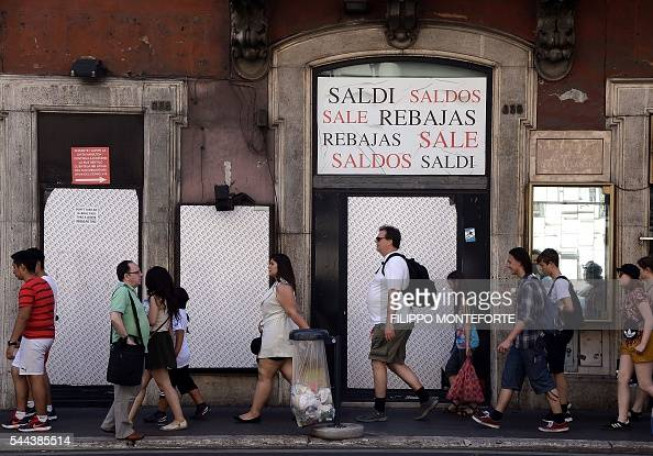 People Walk Past A Closed Shop Indicating Sales In The