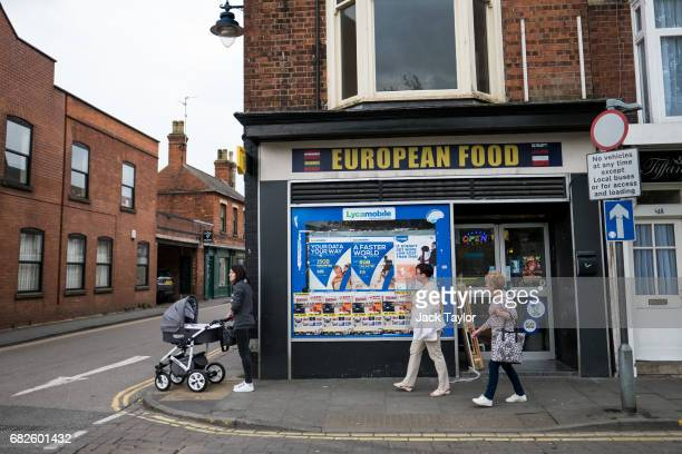 People walk past a European food market on May 12 2017 in Boston United Kingdom The town of Boston in Lincolnshire voted with a 75% majority to leave...