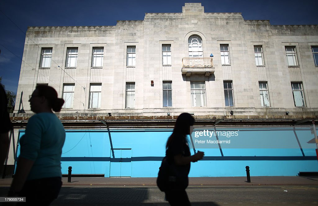 People walk past a former CO-OP store on September 2, 2013 in Dartford, England. High Street campaigner Mary Portas is today facing questions from Members of Parliament on the communities and local government select committee. The traditional high street is under increasing pressure due to the recession and the rise of on-line shopping.