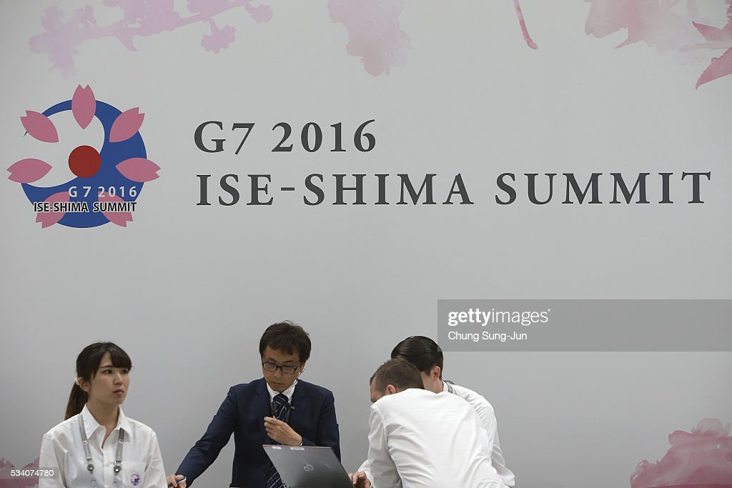People walk past a G7 Summit sign at the IMC on May 24, 2016 in Shima, Japan. The G7 summit will be held in Kashikojima Island of Japan on May 26 and 27, 2016.