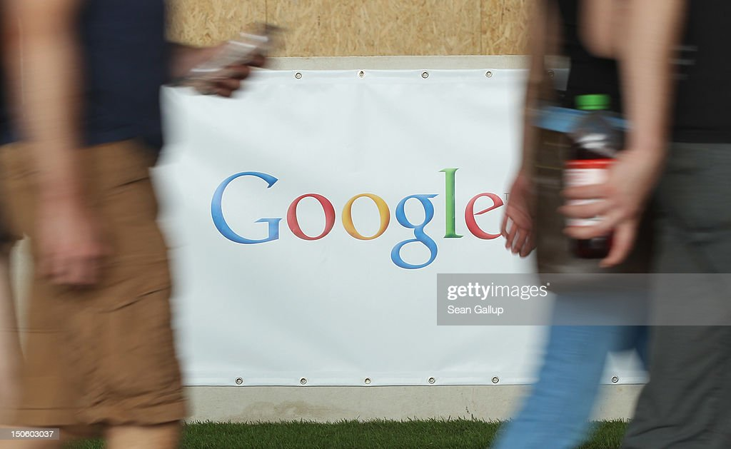 People walk past a Google stand at the Campus Party 2012 technology festival at former Tempelhof Airport on August 22, 2012 in Berlin, Germany. The Campus Party brings together 10,000 technology enthusiasts, hackers, nerds and blogists for five days to concentrate on finding solutions to five problems proposed through the European Digital Agenda from the European Commission.
