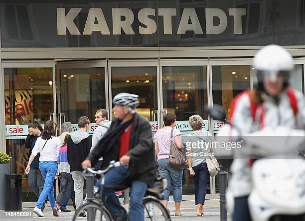 People walk past a Karstadt department store in Steglitz district on July 17 2012 in Berlin Germany Karstadt management recently announced that it...