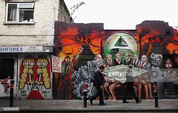 People walk past a large piece of street art near Brick Lane on September 18 2012 in London England
