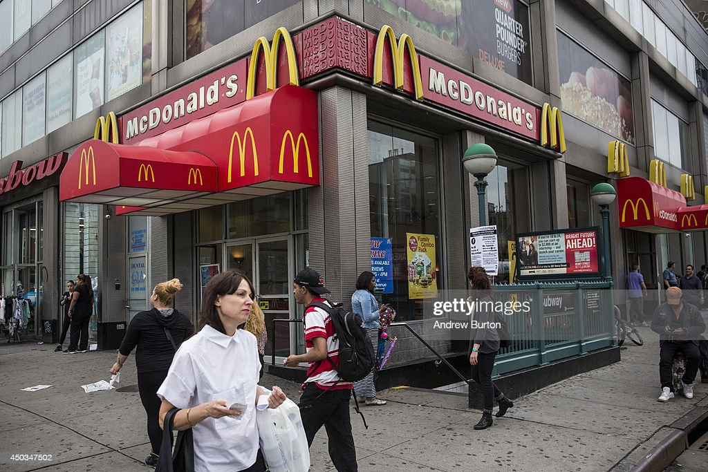 People walk past a McDonald's restaurant on June 9, 2014 in New York City. McDonald's domestic sales rose slightly in May, but remain weak overall.