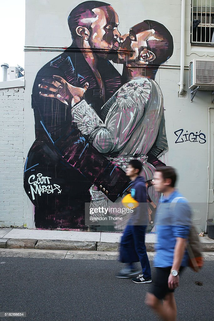 People walk past a mural by artist Scott Marsh is seen on Teggs Lane, Chippendale on March 31, 2016 in Sydney, Australia. The artist and the mural has received world wide attention, with the artist claiming he has been offered money to paint over the work.