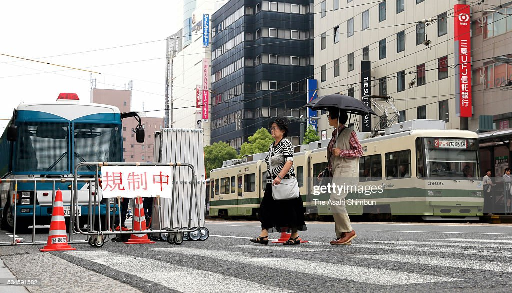 People walk past a Police check point ahead of the visit by U.S. President Barack Obama on May 27, 2016 in Hiroshima, Japan. Obama becomes the first sitting U.S. president to visit Hiroshima, where the first atomic bomb was dropped in 1945 at the end of World War II.