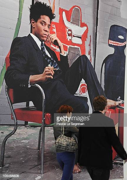 People walk past a poster of artist JeanMichel Basquiat at Paris Museum of Modern Art on October 14 2010 in Paris France