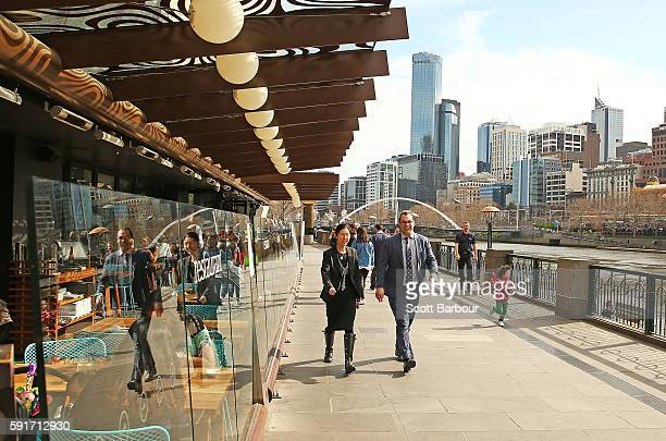 People walk past a restaurant on Southbank Promenade on August 18 2016 in Melbourne Australia Melbourne has been named as the world's most liveable...