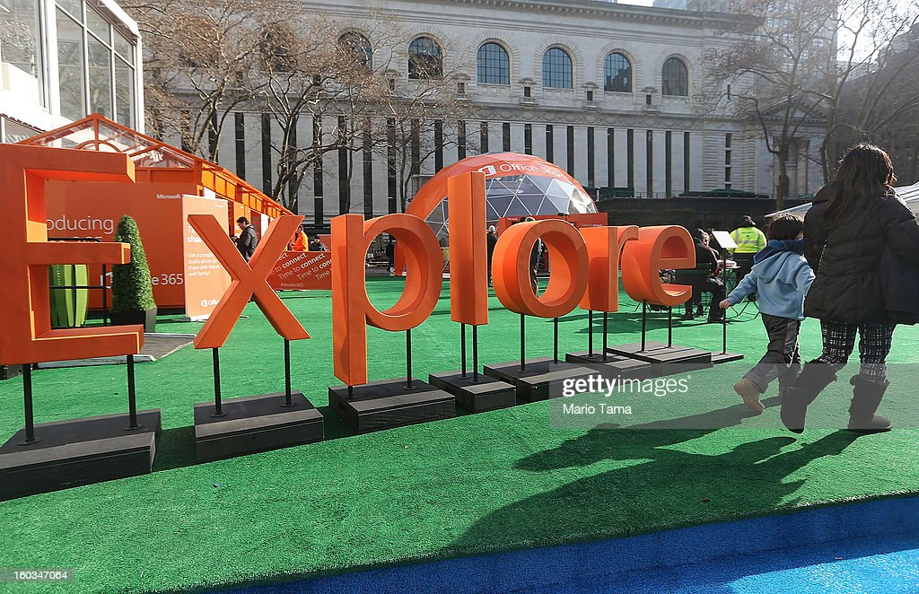 People walk past a sign at the Microsoft Office 2013 launch event in Bryant Park on January 29, 2013 in New York City. Microsoft is launching three versions: Office Professional 2013, Office Home & Student 2013 and Office Home & Business 2013.