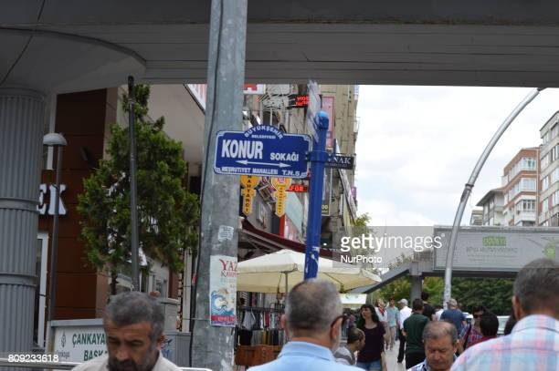 People walk past a sign of Konur Street at Kizilay district in Ankara Turkey on July 05 2017 The Ankara governor's office banned to hold...