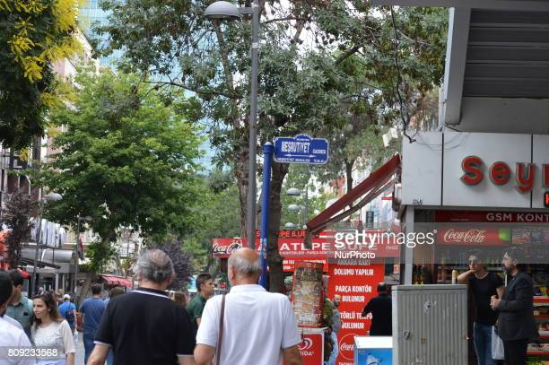 People walk past a sign of Mesrutiyet Street at Kizilay district in Ankara Turkey on July 05 2017 The Ankara governor's office banned to hold...