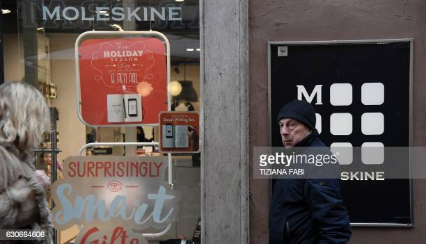 People walk past a store of Italian notebook manufacturer Moleskine in central Rome on December 20 2016 The Italian group's sales have more than...