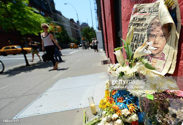 People walk past a street shrine to sixyearold Etan Patz who disappeared 33 years ago set in front of the building where suspect Pedro Hernandez...