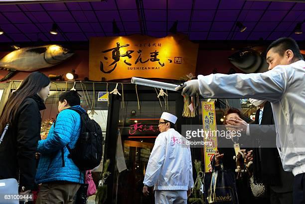 People walk past a Sushi Zanmai restaurant in Tokyo Japan on Thursday Jan 5 2017 Kiyomura KK operator of Sushi Zanmai restaurant made the winning bid...