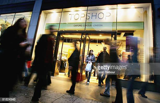 People walk past a Topshop store which is part of the Arcadia Group on October 21 2004 in London England Entrepreneur and owner of retail group...