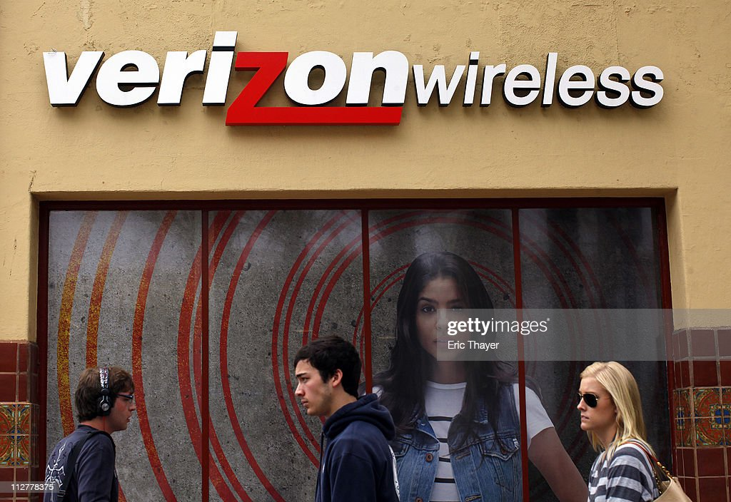 People walk past a Verizon store April 21, 2011 in the Westwood neighborhood of Los Angeles, California. Verizon announced today that it activated 2.2 million iPhones during the first quarter, helping the company more than triple its profit from a year ago. The company reported earnings of $1.4 billion on revenue of $27 billion for the quarter. Profit grew more than three-fold from the $443 million the telecom company earned during the same period last year.