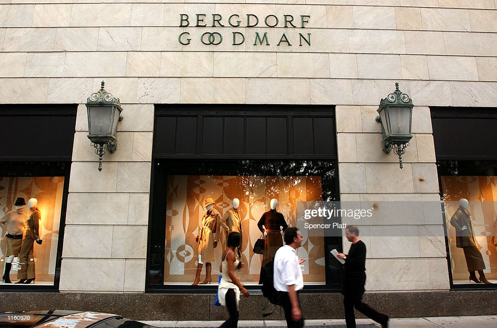 People walk past a window display at the luxury clothing store Bergdorf Goodman September 10 2001 in New York City