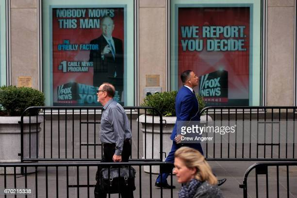 People walk past advertisements for Fox News and Bill O'Reilly outside of the News Corp and Fox News headquarters in Midtown Manhattan April 19 2017...