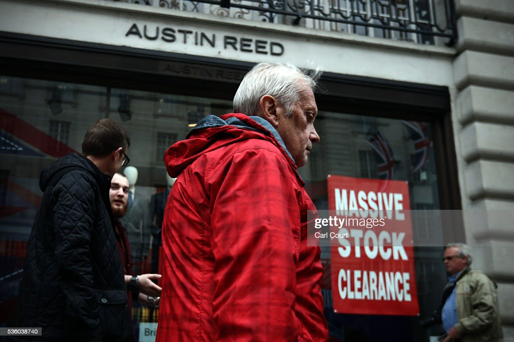 People walk past an Austin Reed store on May 31, 2016 in London, England. After going into administration last month and failing to find a buyer, the company today announced that all 120 Austin Reed stores will close by the end of June with a loss 1,000 jobs.