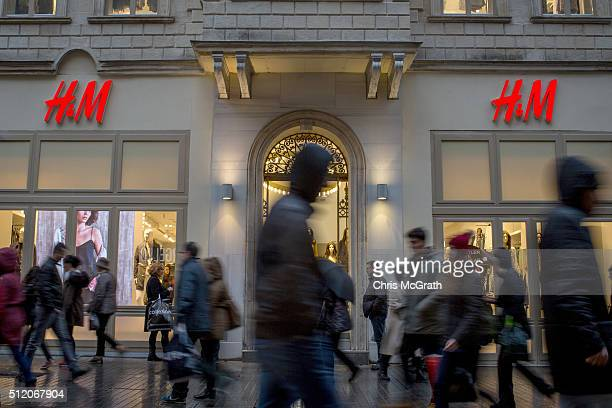 People walk past an HM store on February 24 2016 in Istanbul Turkey Recent terrorist attacks national conflicts the refugee crisis and the recent...