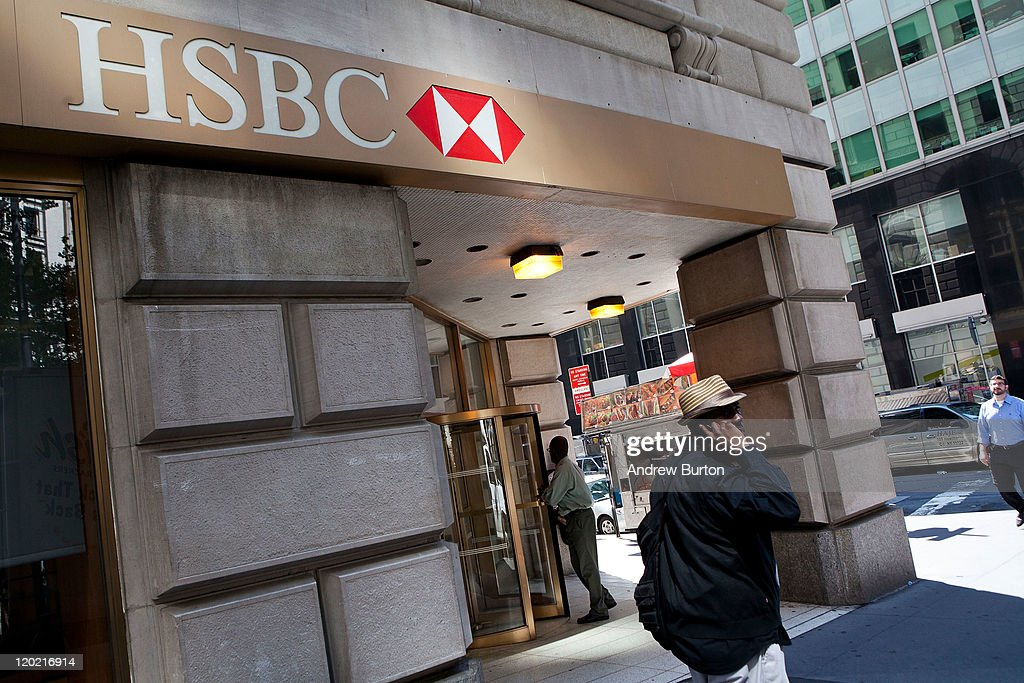 People walk past an HSBC Bank branch at 26 Broadway August 1, 2011 in New York City. According to reports. HSBC will eliminate 30,000 jobs worldwide and sell 195 branches, mostly in upstate New York, to First Niagara Financial for about $1 billion.
