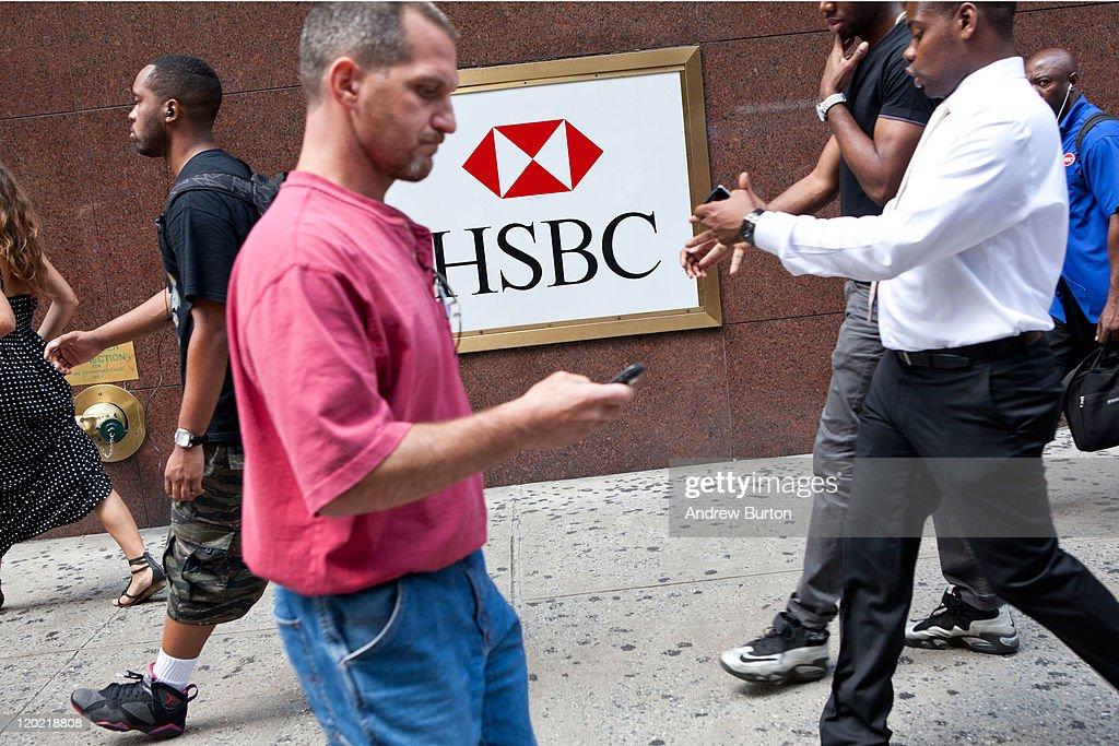 People walk past an HSBC Bank branch at 550 Fashion Avenue on August 1, 2011 in New York City. According to reports HSBC will eliminate 30,000 jobs worldwide and sell 195 branches, mostly in upstate New York, to First Niagara Financial for about $1 billion.