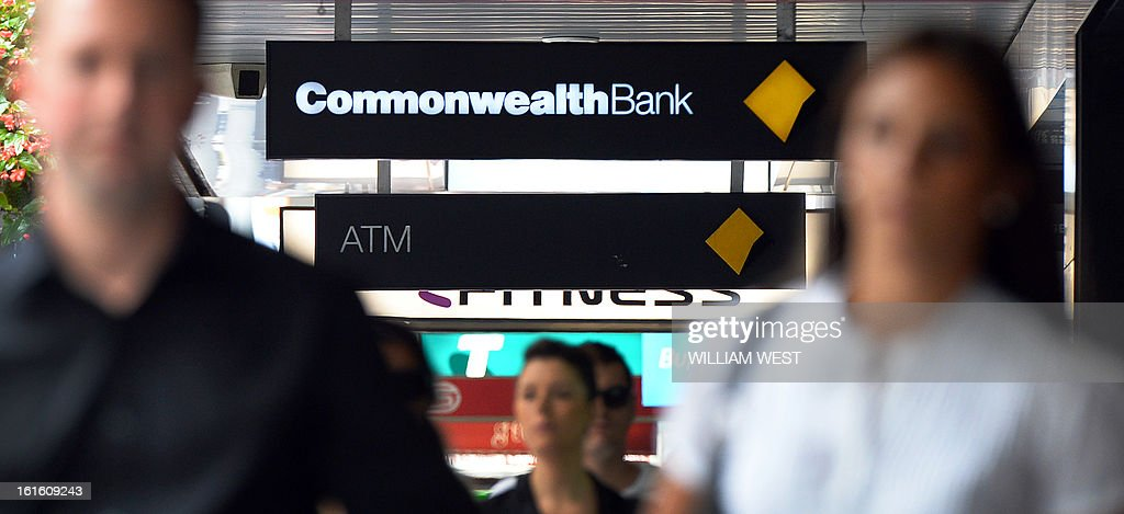People walk past an inner-city branch of Australia's largest lender Commonwealth Bank which posted a one percent rise in first-half net profit to Aus$3.66 billion (US$3.77 billion) despite subdued market conditions, in Sydney on February 13, 2013. The bank's result for the six months to December 31 was up from $3.62 billion in the same period the previous year. Its cash profit, a measure often preferred by financial institutions, rose six percent to Aus$3,78 billion, slightly above analyst expectaions. AFP PHOTO/William WEST