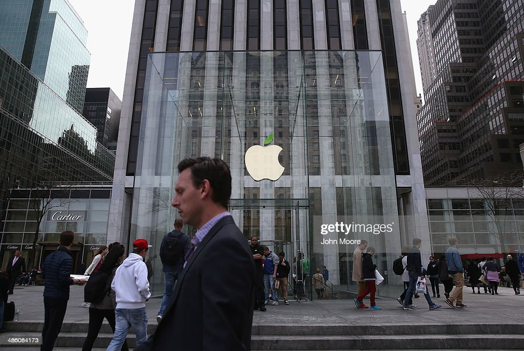 People walk past Apple's Fifth Avenue store on Earth Day in Midtown Manhattan on April 22 2014 in New York City The store is one of at least 120...