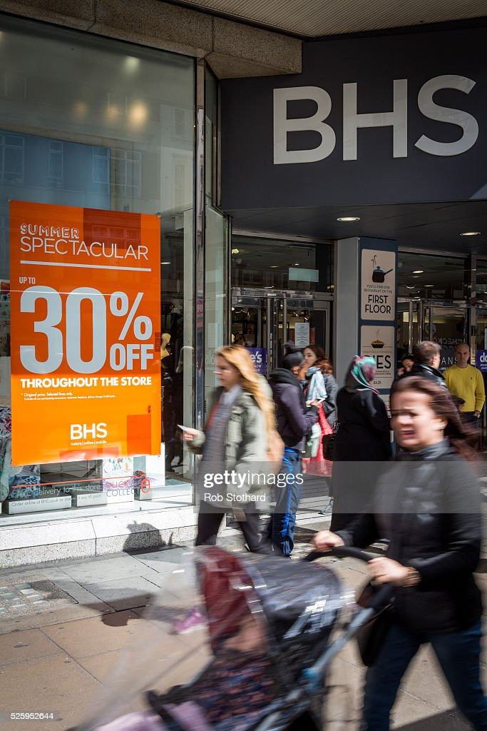 People walk past British Home Stores (BHS) on Oxford Street on April 29, 2016 in London, England. The department store BHS has filed for administration putting almost 11,000 jobs at risk. The retailer, who has over 150 stores nationwide, have debts topping ��1.3bn including a pensions deficit of ��571m.