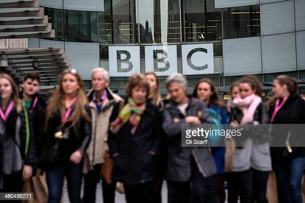 People walk past Broadcasting House the headquarters of the BBC on March 25 2014 in London England MPs have today voted in favour of an amendment to...