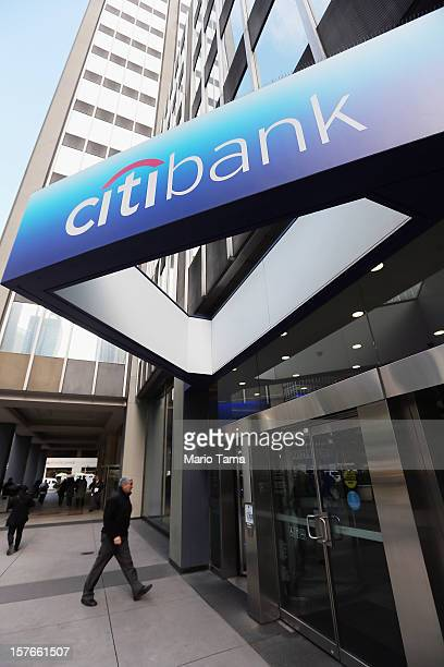 People walk past Citibank headquarters in Manhattan on December 5 2012 in New York City Citigroup Inc today announced it was laying off 11000 workers...