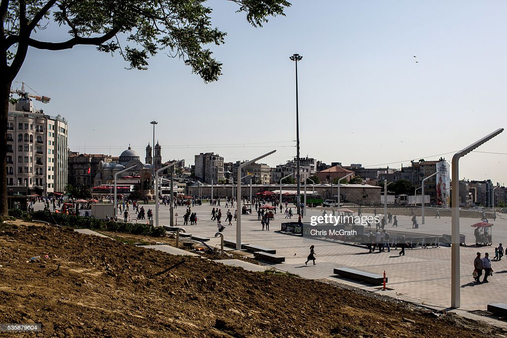 People walk past construction being done in Gezi Park on the eve of the 3rd anniversary of the Gezi Park protests on May 30, 2016 in Istanbul, Turkey. The protests began on May 28, 2013 to contest the planned urban development of Gezi Park however larger protests started after police evicted protesters from the park sparking weeks of civil unrest.