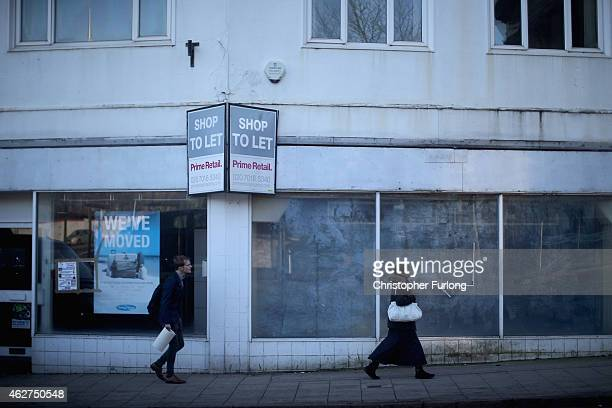 People walk past empty shops in Burslem on February 4 2015 in Burslem StokeonTrent United Kingdom The North South divide is demonstrated by latest...